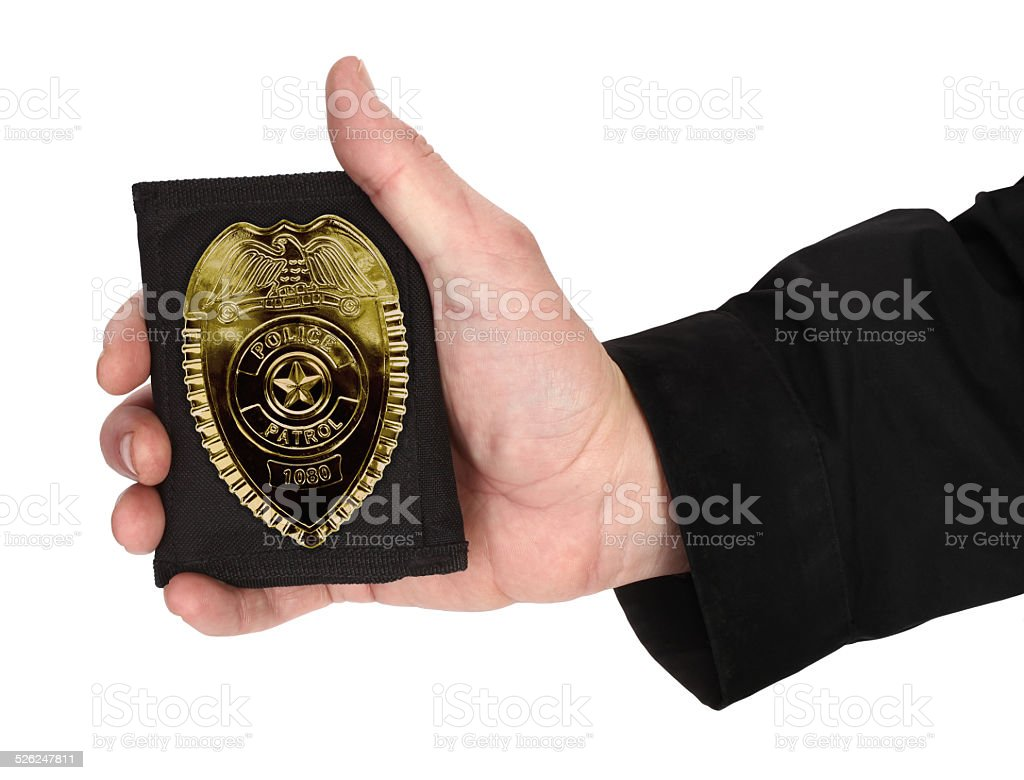 Man hand is holding police badge stock photo