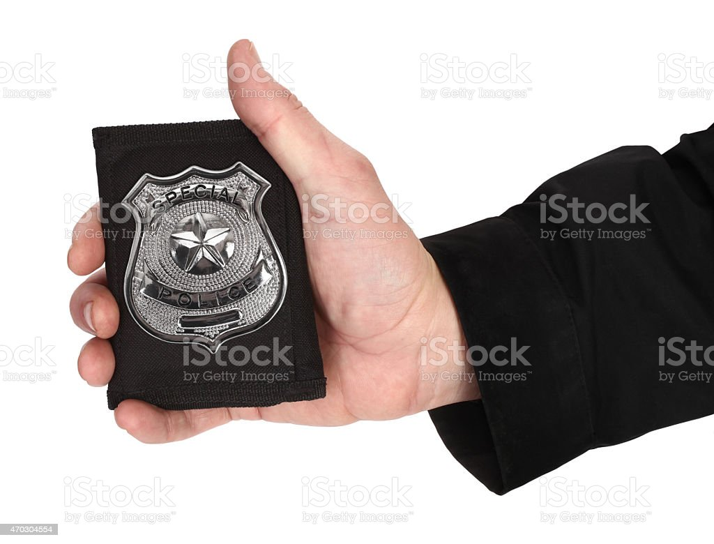 Man hand is holding special police badge stock photo