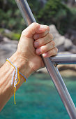 Man hand on the handrail in ship sailing