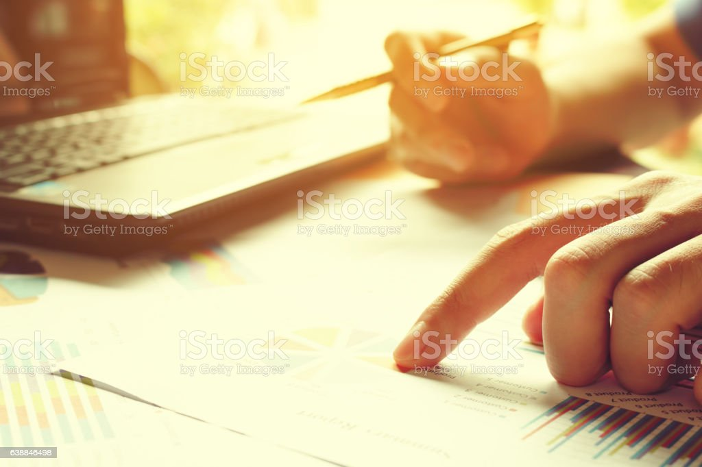 Man hand pointing on sumary report with calculate about cost stock photo