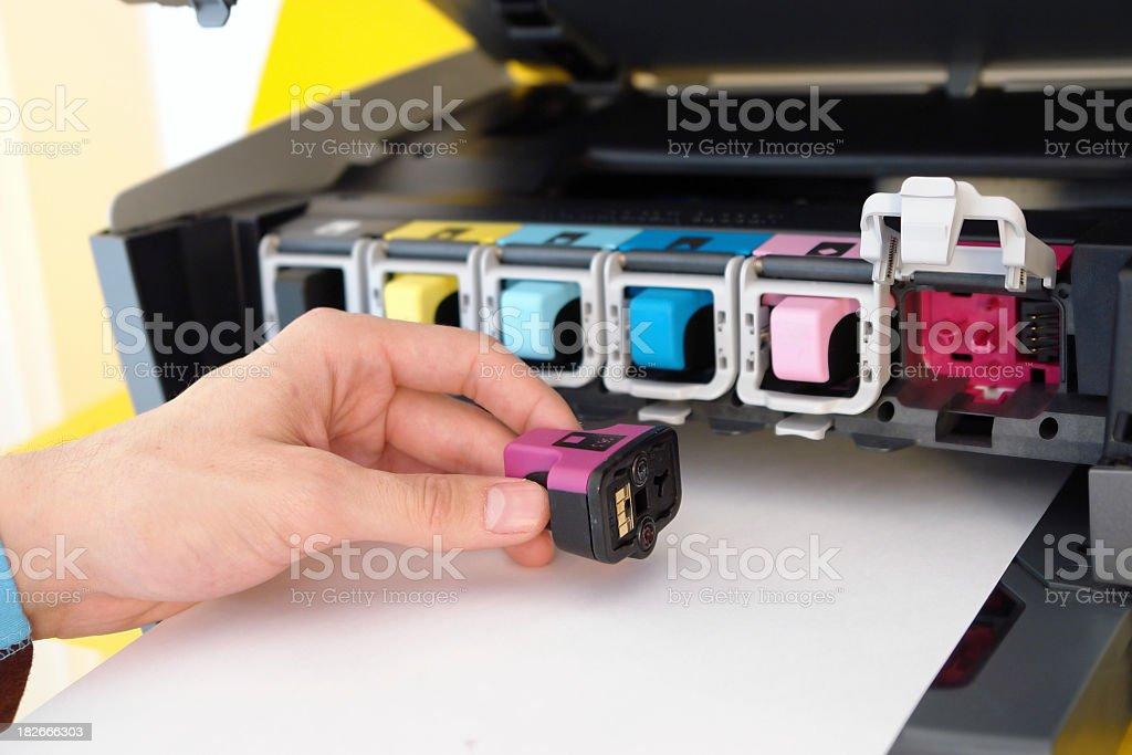 Man hand replacing inkjet cartridge stock photo