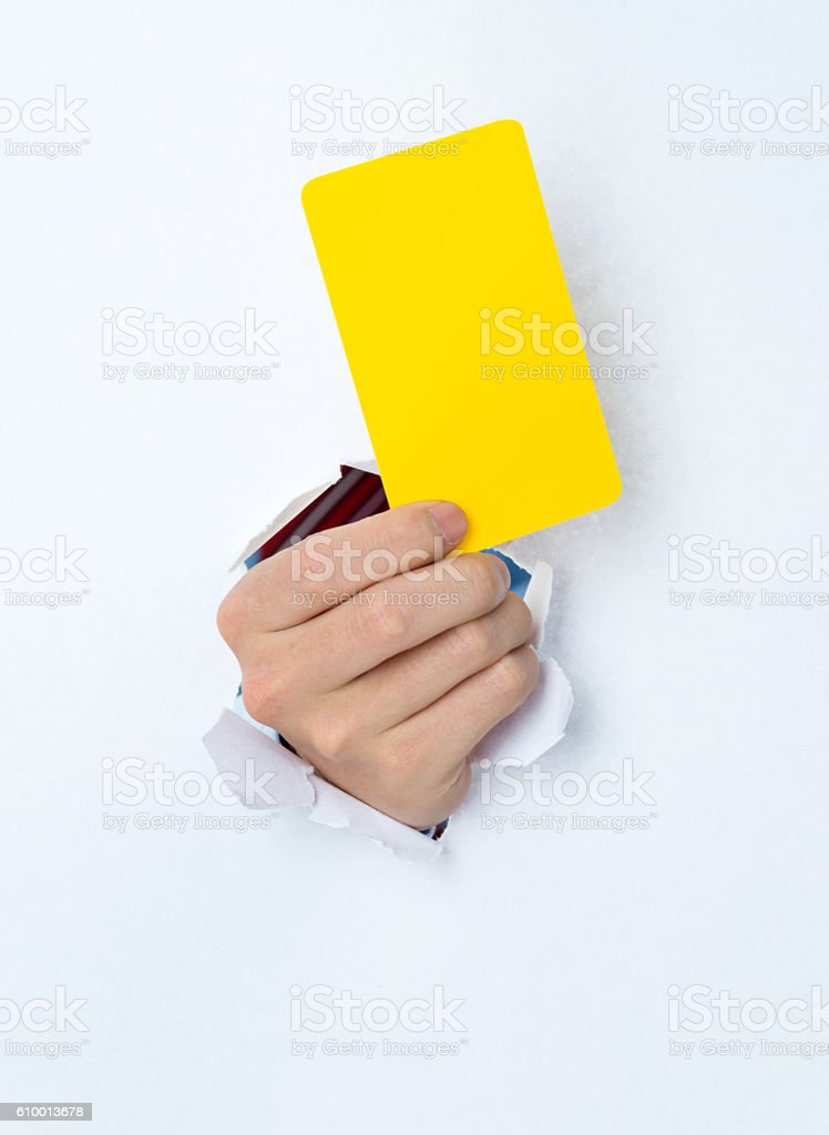 Man hand showing blank card through a hole stock photo