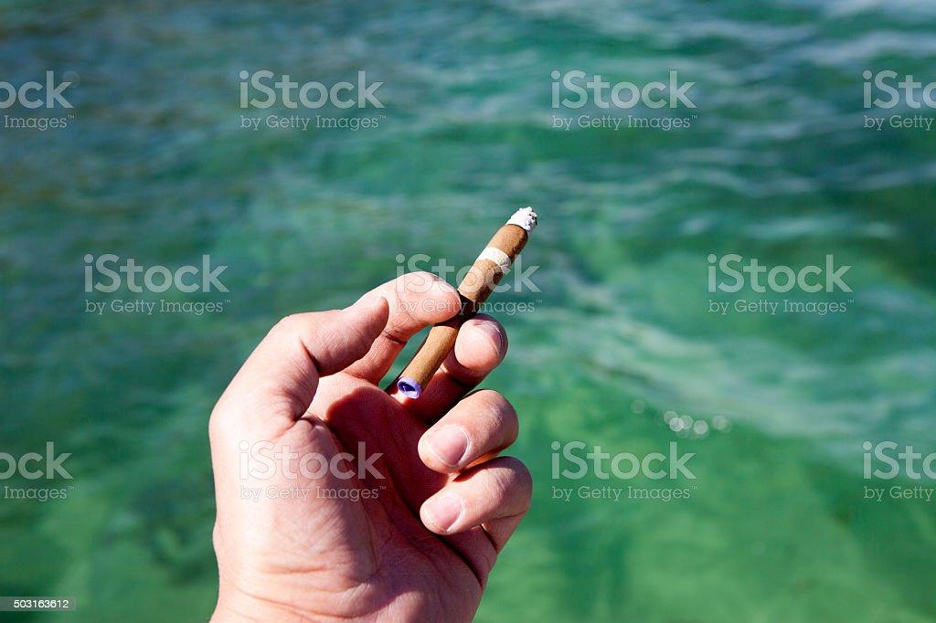 Man Hand smoking stock photo