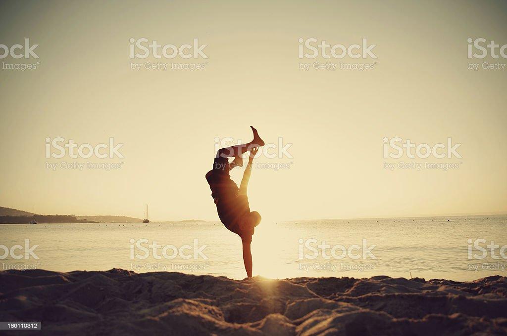 Man hand standing on the beach stock photo