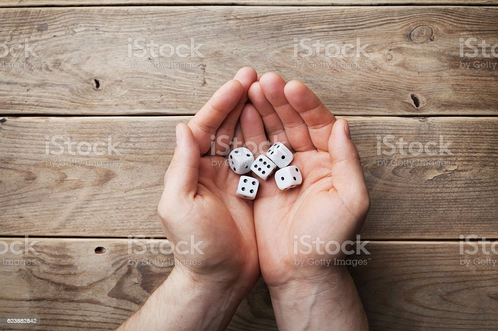 Man hand throwing dice. Gambling devices. Casino concept. Flat lay. stock photo