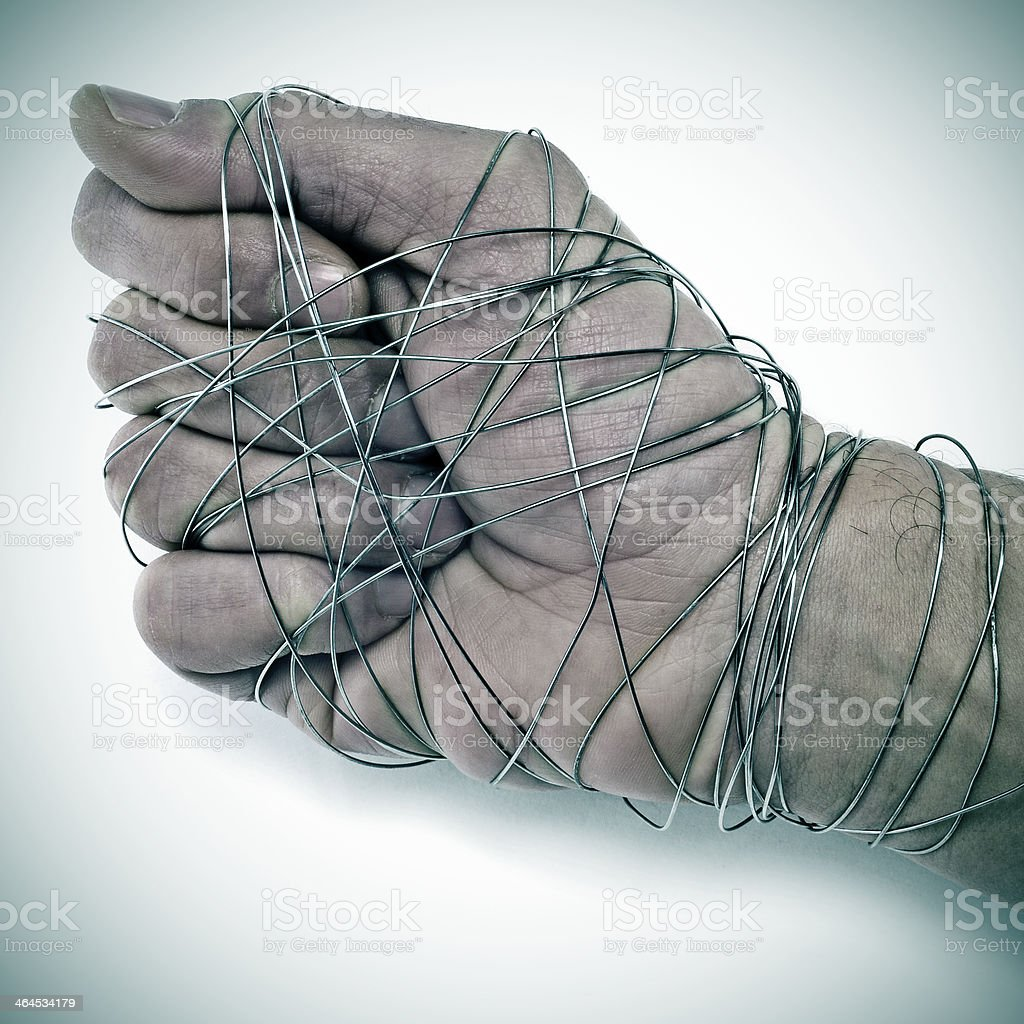 man hand tied with wire stock photo
