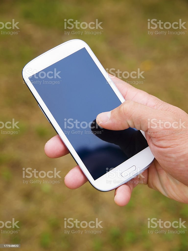 Man hand touching screen on modern mobile smart phone 2 royalty-free stock photo