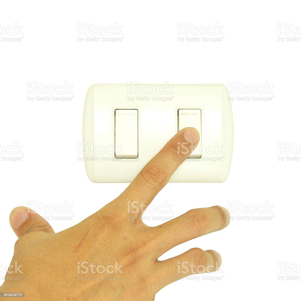 Man hand turn off light switch isolated on white background stock photo