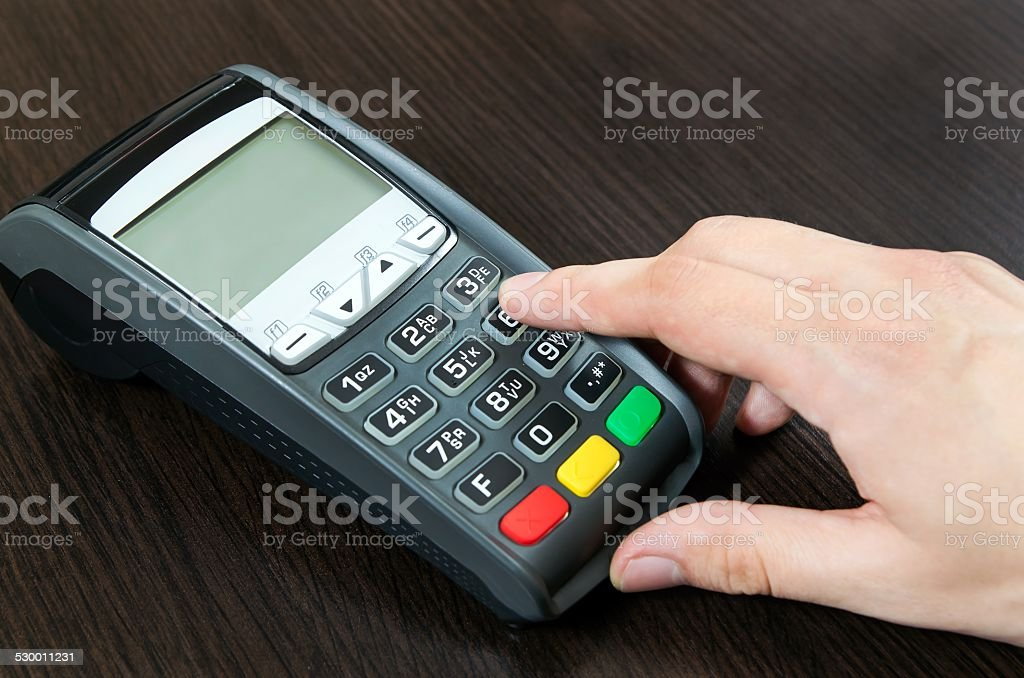 Man hand using payment terminal in shop stock photo