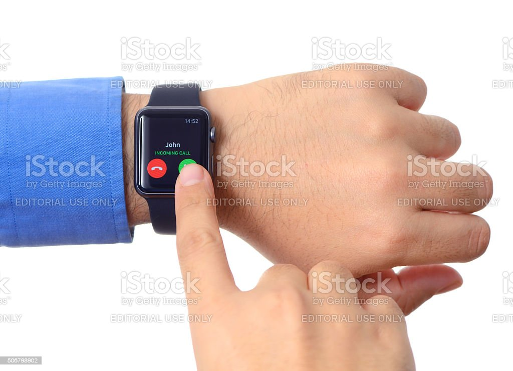 Man hand wearing an Apple Watch stock photo