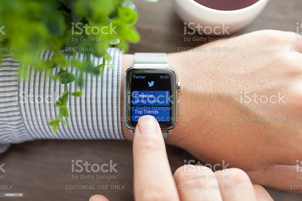 Man hand with Apple Watch and app Twitter on screen stock photo