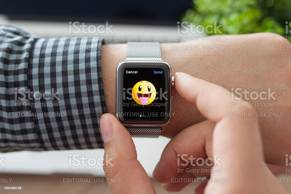 Man hand with Apple Watch and smile on a screen stock photo