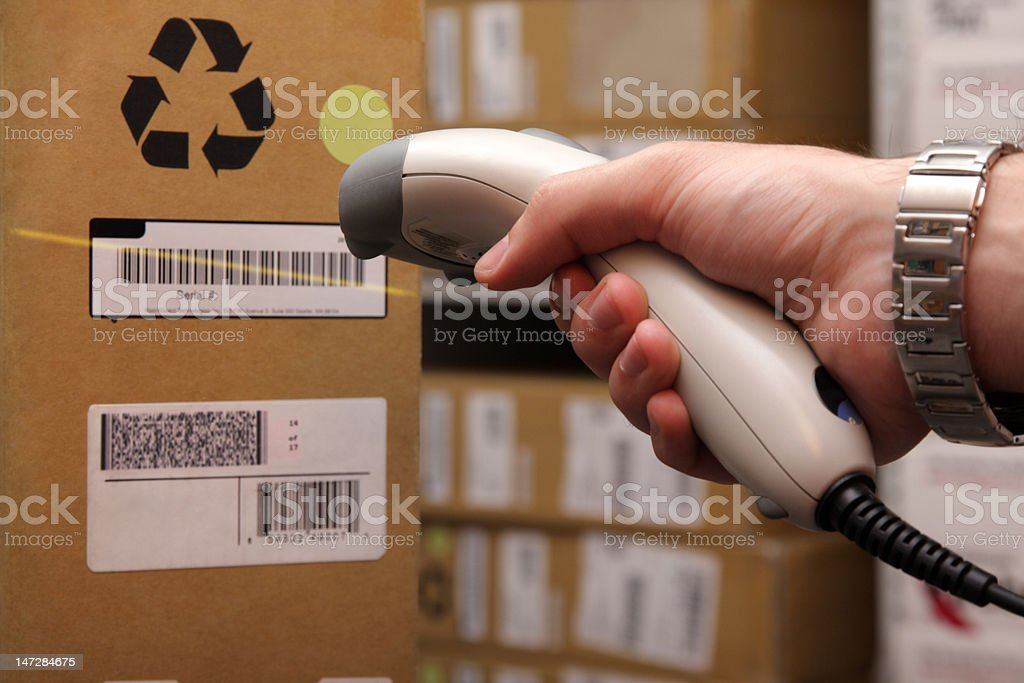 Man hand with barcode scanner in operation. stock photo