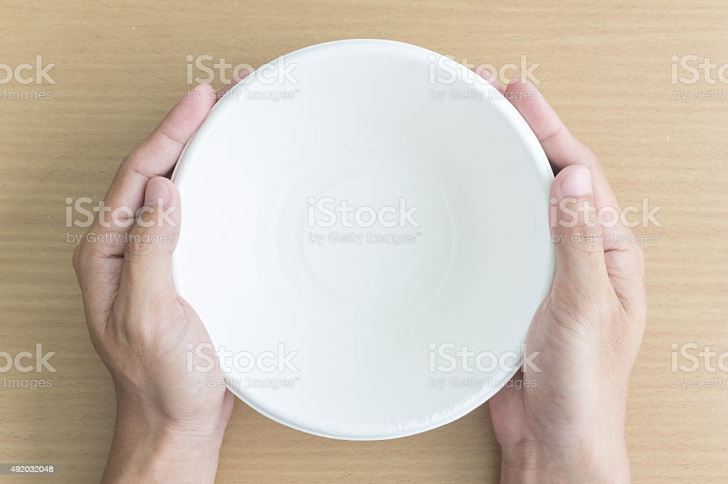 man hand with empty bowl stock photo