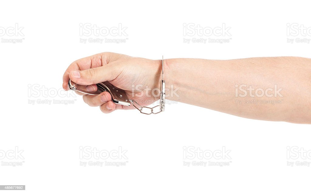 Man hand with handcuffs isolated on white background stock photo