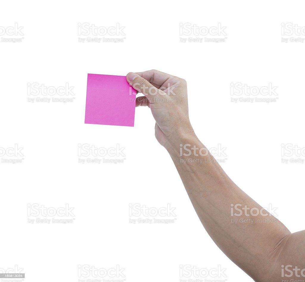 Man hand with pink adhesive note isolated on white background royalty-free stock photo
