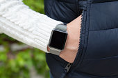 man hand with smart watch in the pocket on street