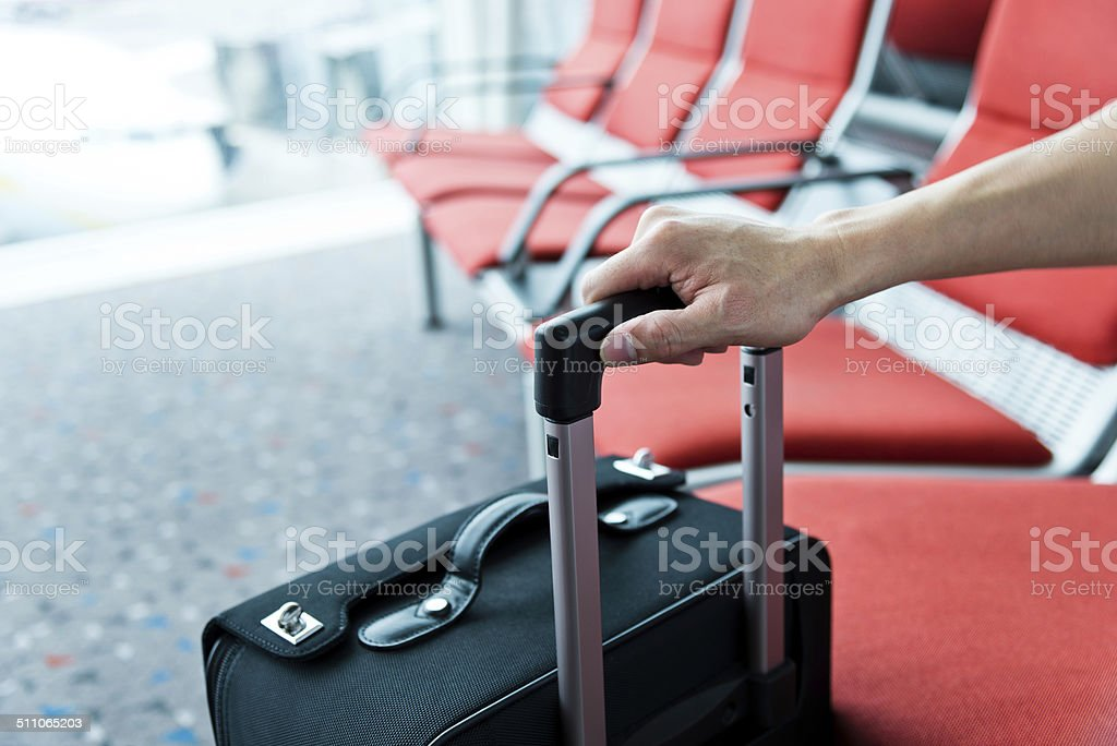 man hand with suitcase stock photo