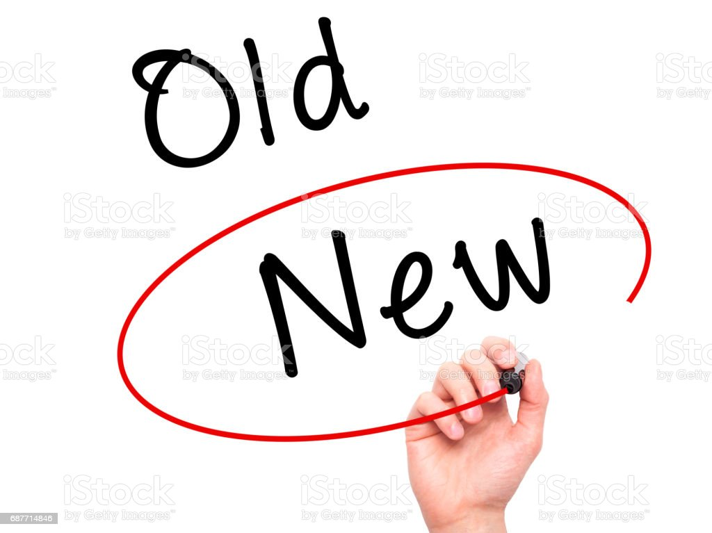 Man Hand writing and choosing New instead of Old with black marker on visual screen stock photo