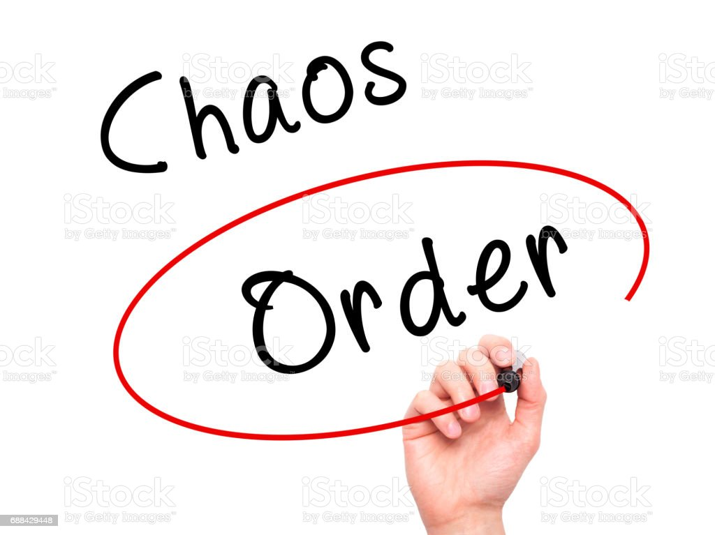 Man Hand writing and Choosing Order instead of Chaos with black marker on visual screen stock photo