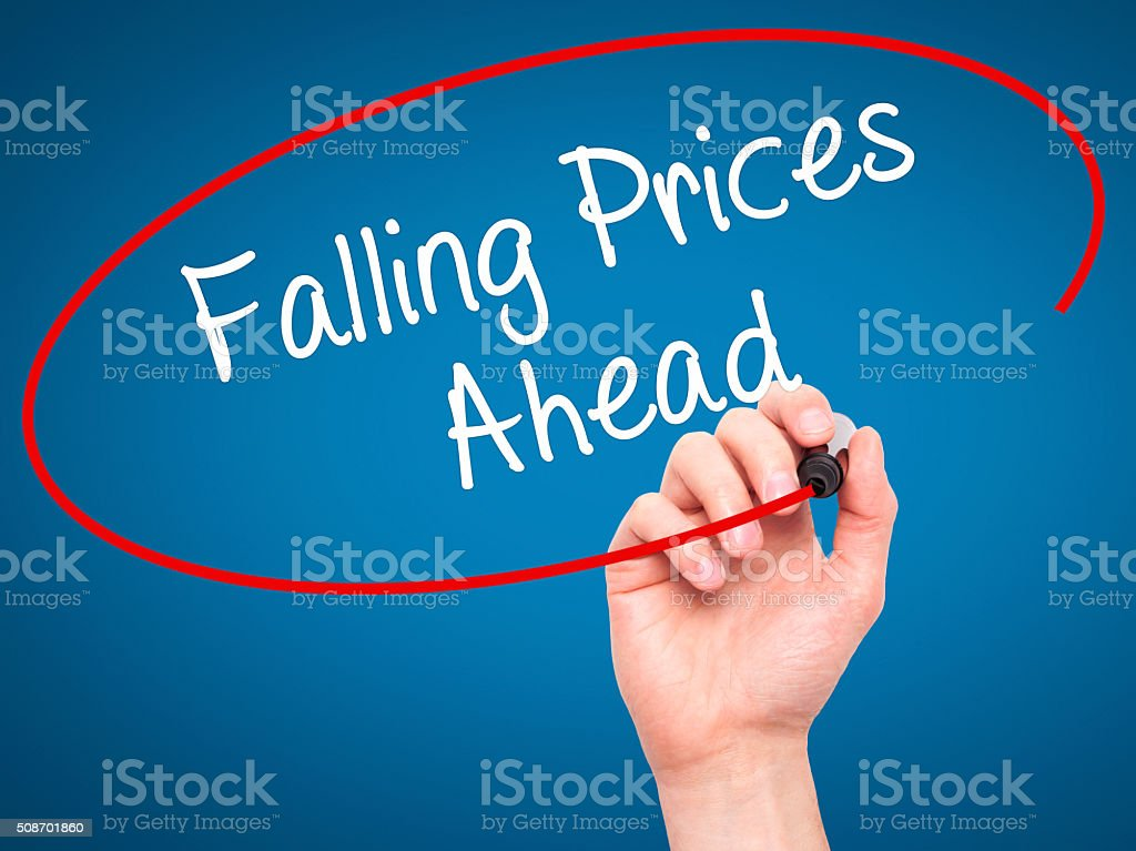 Man Hand writing Falling Prices Ahead with black marker stock photo