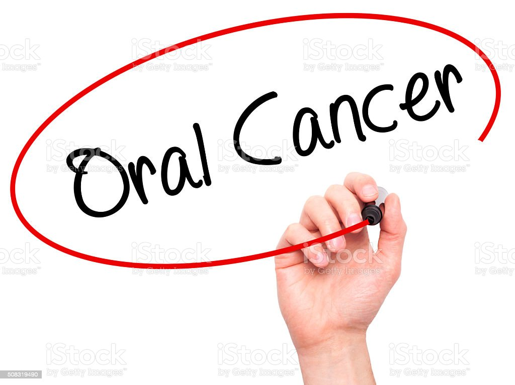 Man Hand writing Oral Cancer with black marker stock photo