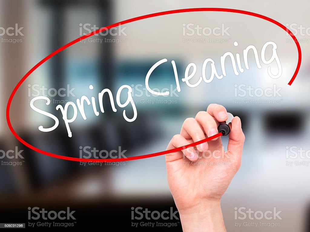 Man Hand writing Spring Cleaning with black marker stock photo