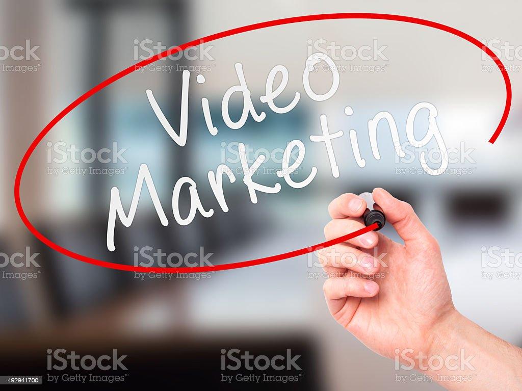 Man Hand writing Video Marketing black marker on visual screen stock photo