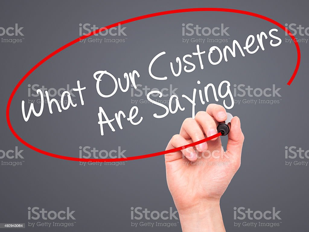 Man Hand writing What Our Customers Are Saying with marker stock photo