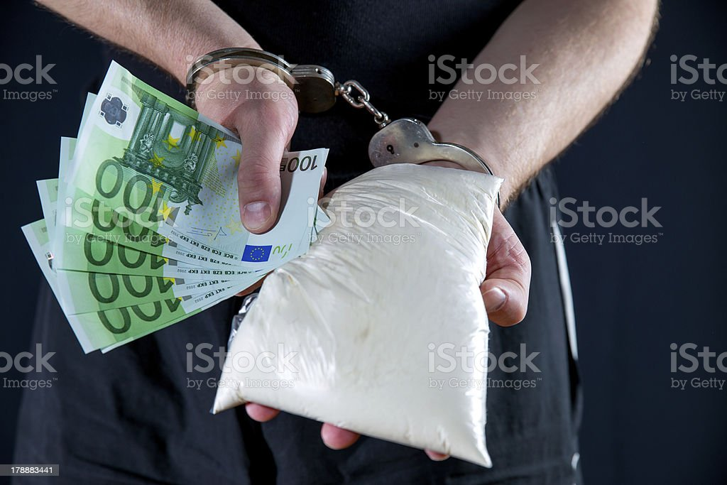 Man handcuffed for his crimes royalty-free stock photo