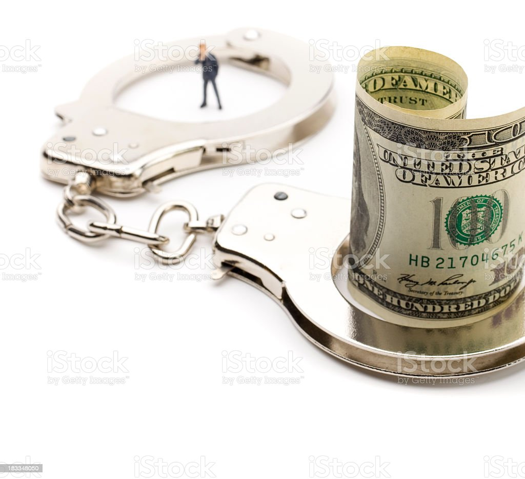 Man handcuffed to money royalty-free stock photo