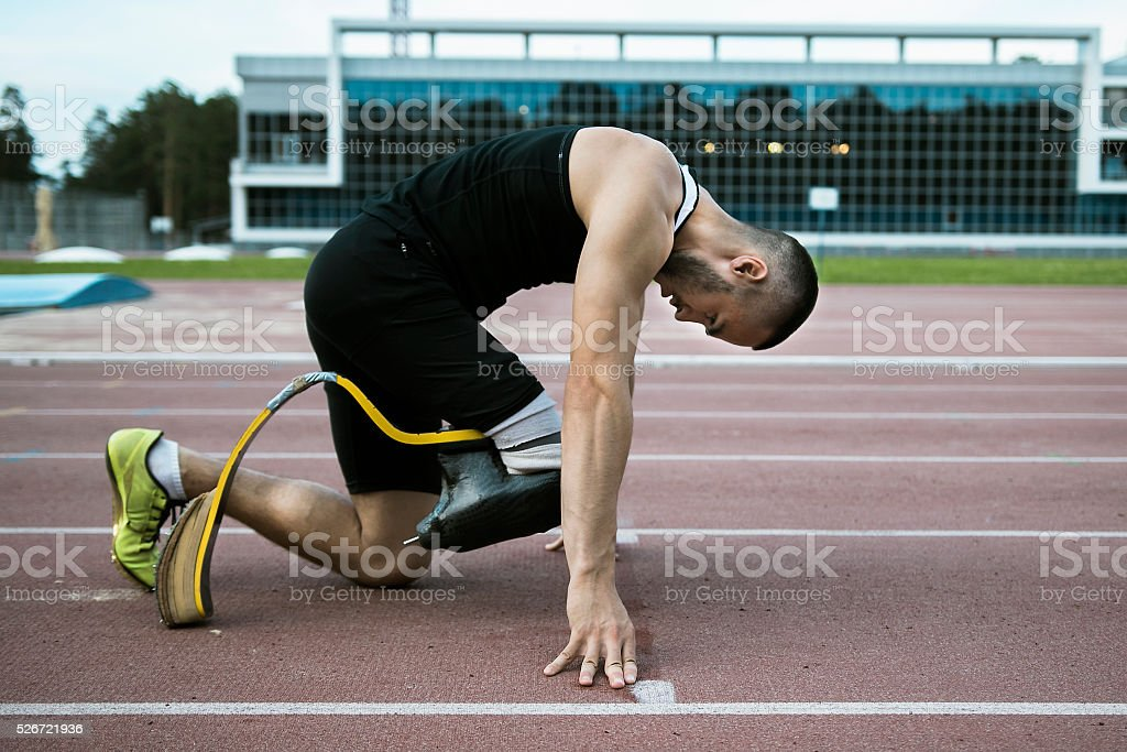 Man handicap athlete stock photo