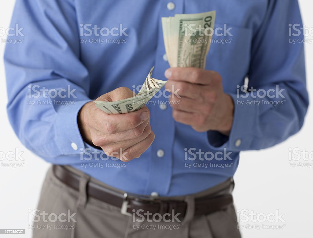 Man handing out cash stock photo