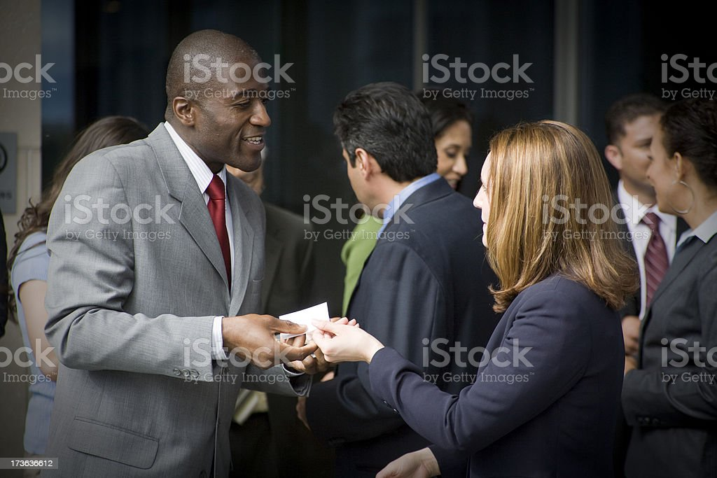 Man handing out his business card at a meet and greet stock photo