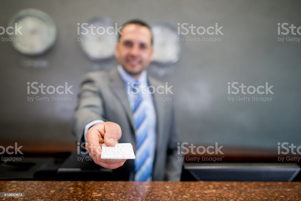 Man handling card key at a hotel stock photo