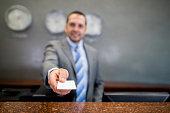 Man handling card key at a hotel