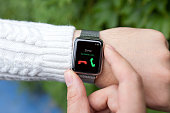man hands and smart watch with call in the screen