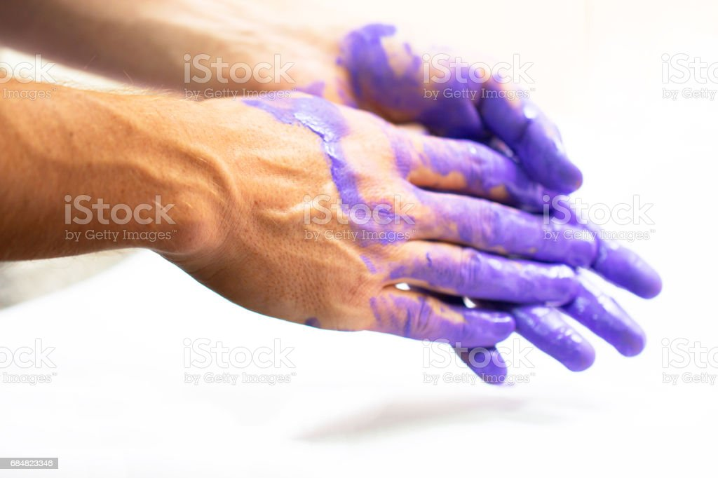 Man hands dirty by purple paint stock photo