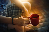 man hands holding cup of coffee