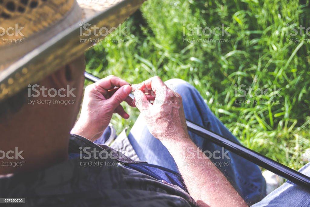 Man hands holding fishing baits. stock photo