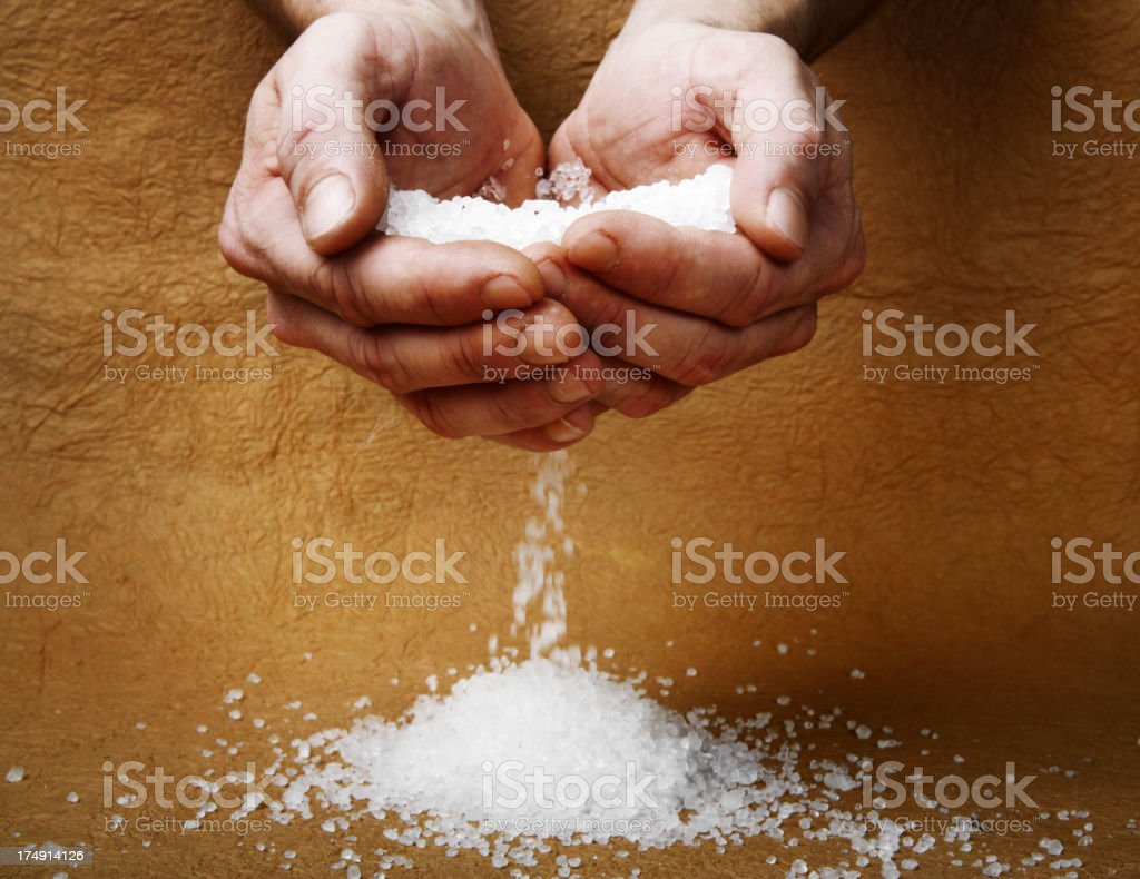 Man hands holding salt stock photo