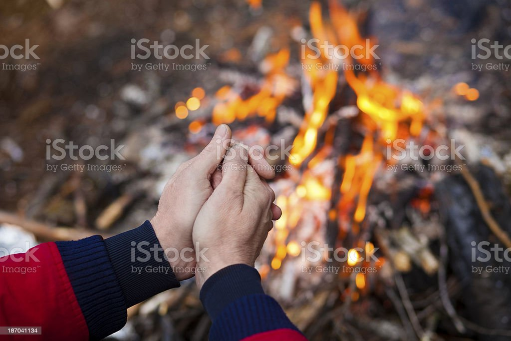 Man hands on bonfire background royalty-free stock photo