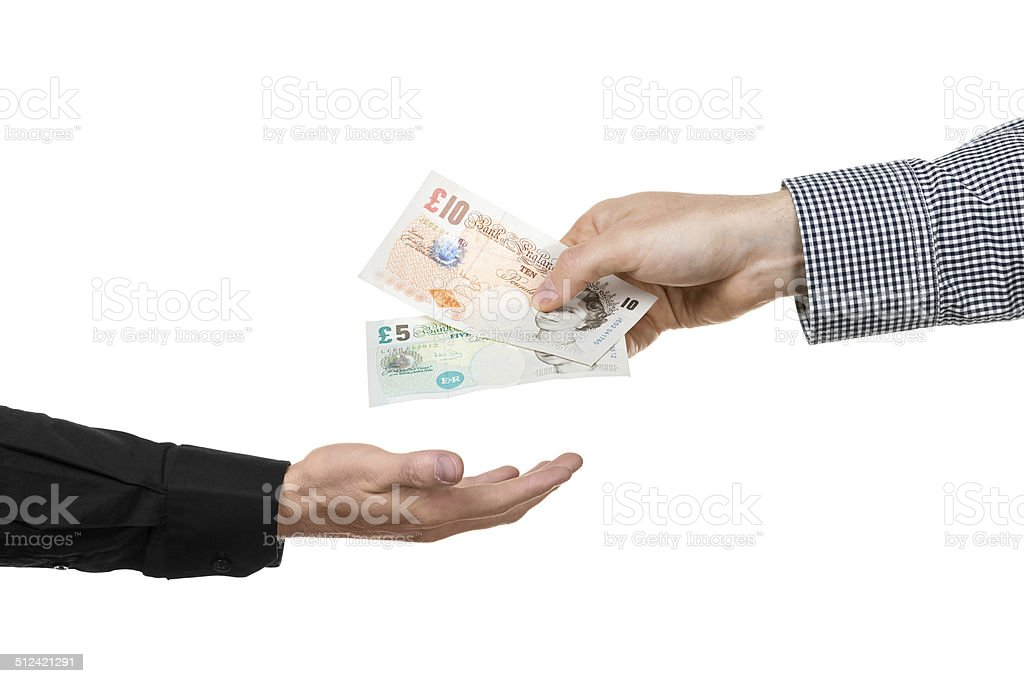 Man hands over british pound banknotes to another man stock photo