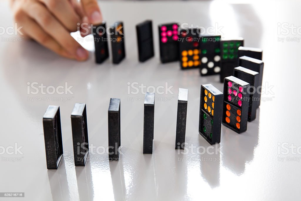 Man Hands playing domino on shiny desk stock photo