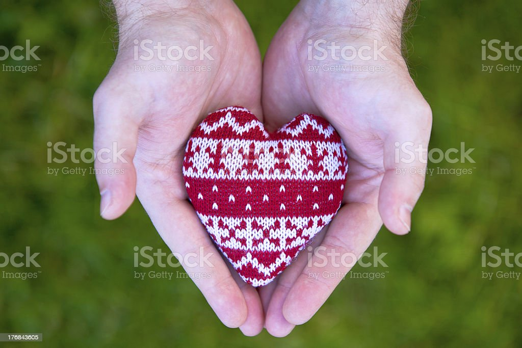 man hands with red knitted heart royalty-free stock photo