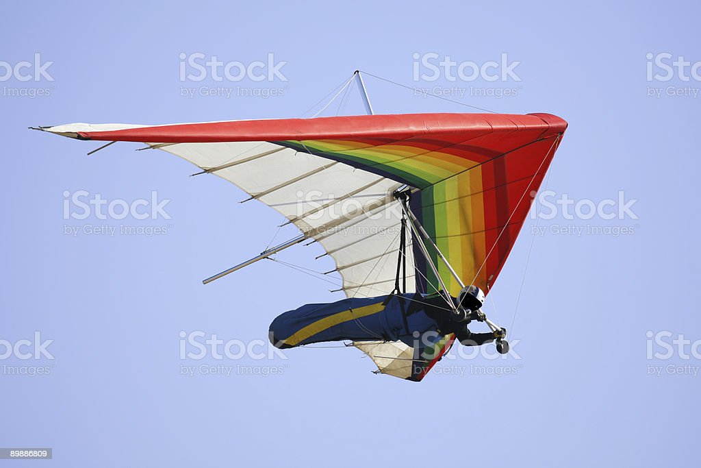 Man hang gliding with blue sky at the background stock photo