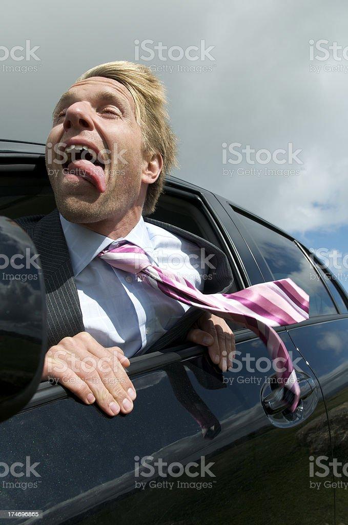 Man Hangs His Tongue Out Car Window stock photo
