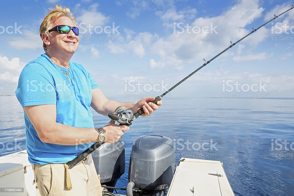 Man happily fishing on a sunny day. royalty-free stock photo