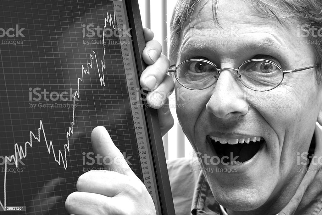 man happy about positive stock exchange rate or company profit stock photo