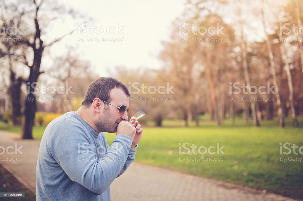 Man has a bad habit stock photo